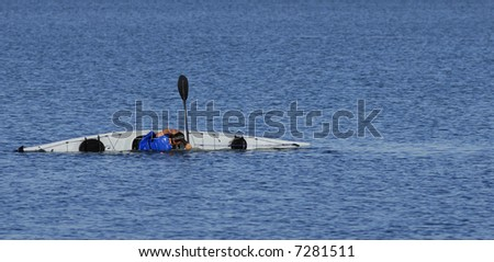 Kayaker performs float-asisted roll