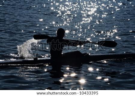 kayaker's silhouette - stock photo