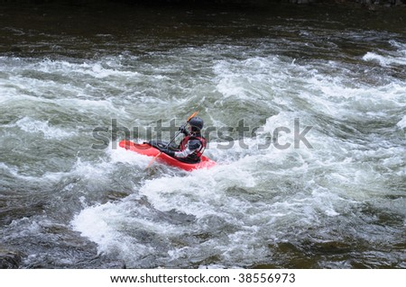 Kayaker, surfing the wave - stock photo
