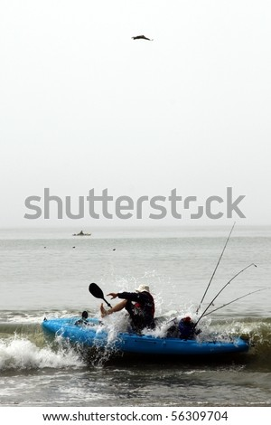 Kayaker surprised by a wave - stock photo