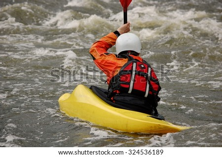 Kayaker training on a rough water. Southern Bug river, Ukraine. - stock photo