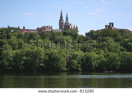 Kayakers on the Potomac, with Georgetown University in the background. - stock photo