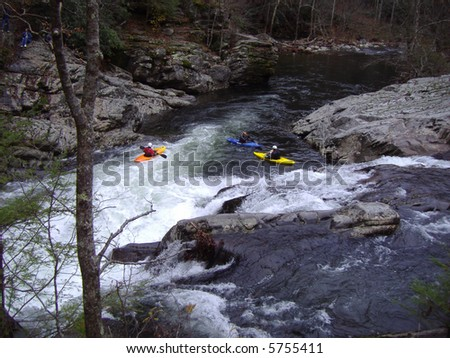 Kayakers riding a mountain stream - stock photo