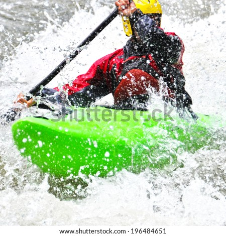 Kayaking as extreme and fun sport - stock photo