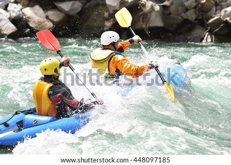 Kayaking as extreme and fun team sport - stock photo