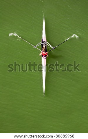 Kayaking down the river, young man rowing in kayak down the river, top view - stock photo
