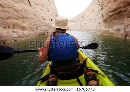 Kayaking in a canyon - stock photo