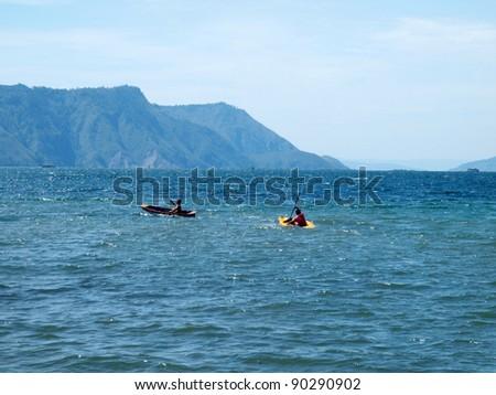 Kayaking in Lake Toba Sumatra - stock photo