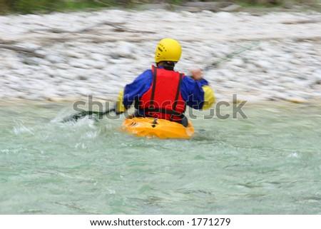 kayaking in mountain river - motion blur - stock photo