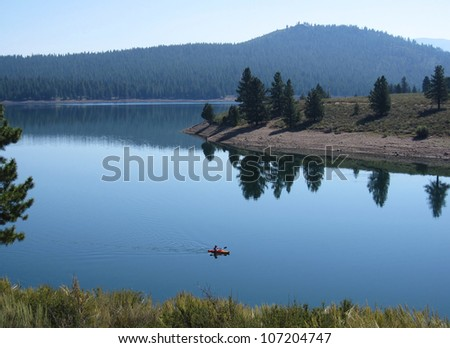 Kayaking in the glassy calm water of the Prosser reservoir near Lake Tahoe