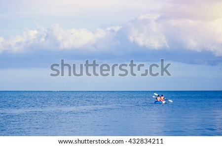 Kayaking in the sea with gradient sky