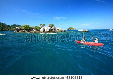 kayaking in tropical lagoon - stock photo
