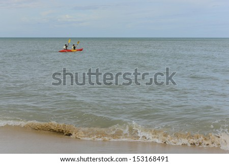 Kayaking into the deep blue sea. - stock photo