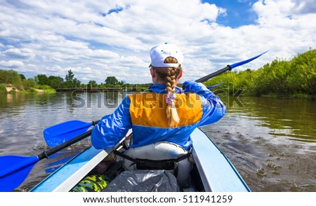 Kayaking on beautiful nature at summer sunny day. Sport people having fun a river