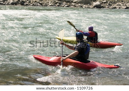 Kayaking on the Bhote Koshi in Nepal. The river has class 4-5 rapids. - stock photo
