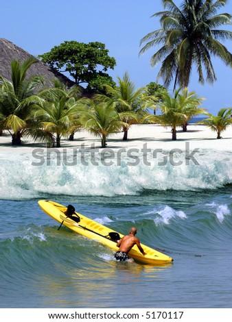 Kayaking on tropical Caribbean island - stock photo