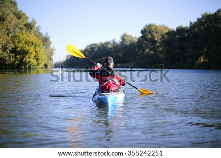 Kayaking the Colorado River (Between Lees Ferry and Glen Canyon Dam) - stock photo