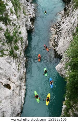 Kayaking through river gorge. Top view - stock photo