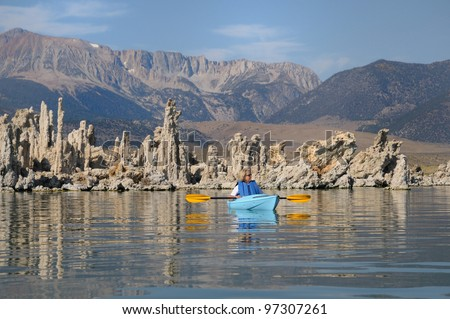 Kayaking through tufas at Mono Lake in California - stock photo