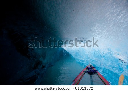 Kayaking to the Inside of the ice cave in glacier iceberg, Alaska