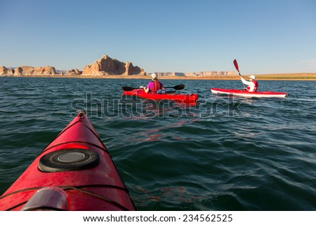 Kayaking Travel Adventure on Lake Powell in the Glen Canyon National Recreation Area. - stock photo