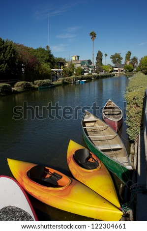 kayaks and boats on the venice canals - stock photo