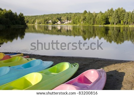 Kayaks and Canoes at a lake - stock photo