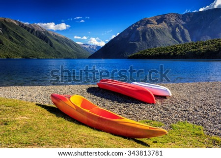 kayaks and mountain lake, location - Nelson Lakes National Park, South Island, New Zealand - stock photo