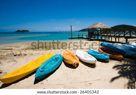Kayaks on a tropical beach