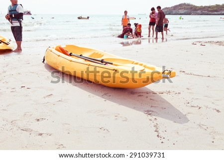 kayaks on the beach. - stock photo