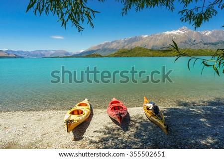 Kayaks on the Lake Wakatipu, Glenorchy, New Zealand - stock photo