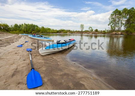 Kayaks on the river, tourism - stock photo
