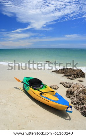 Kayaks on the tropical beach - stock photo