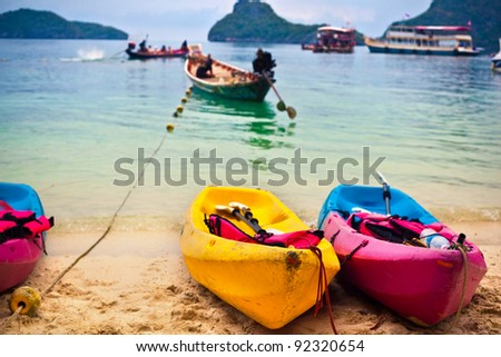 Kayaks on the tropical beach, Thailand - stock photo
