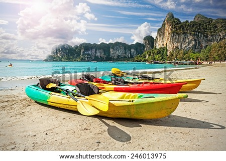 Kayaks on tropical beach, active holidays concept. - stock photo