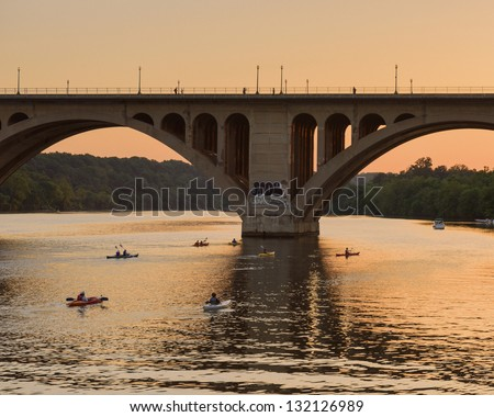 Kayaks Returning At Sunset On The Potomac River - stock photo