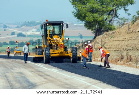 KAYSERI - AUGUST 15: workers repairs road under the program of planned on August 15 2014  in kayseri  Turkey - stock photo