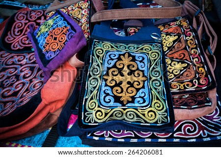 Kazakh ethnic bags with ornament in the market at Nauryz celebration in Almaty, Kazakhstan, central Asia - stock photo