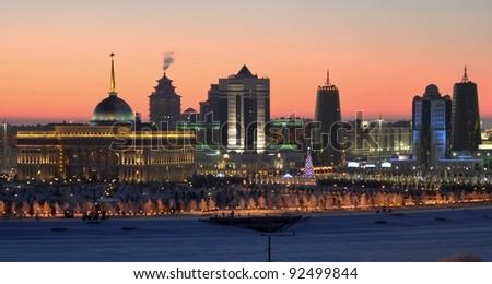 Kazakhstan Astana skyline illuminated - stock photo