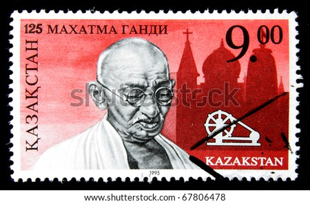 KAZAKHSTAN - CIRCA 1995: A post stamp printed in Kazakhstan shows portrait of Mohandas Karamchand Gandhi, circa 1995 - stock photo