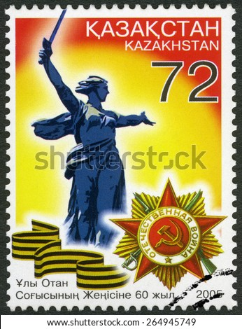 "KAZAKHSTAN - CIRCA 2005: A stamp printed in Kazakhstan shows the sculpture ""Motherland"" and the Order of the Patriotic War, End of World War II, 60th, circa 2005 - stock photo"