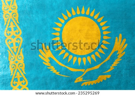 Kazakhstan Flag painted on leather texture - stock photo