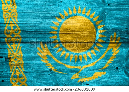 Kazakhstan Flag painted on old wood plank texture - stock photo