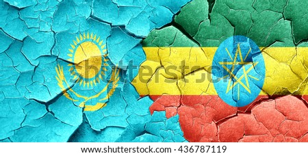Kazakhstan flag with Ethiopia flag on a grunge cracked wall - stock photo