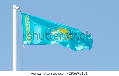 Kazakhstan waving flag against blue sky