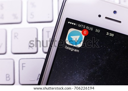 Kazan Russia 07.08.2016: iphone 5s with facebook messenger logo on screen, apple keyboard. Illustrative editorial image