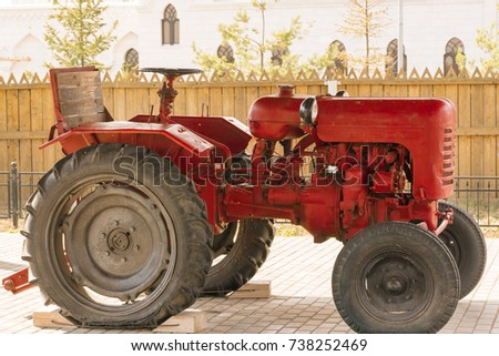 KAZAN, RUSSIA, NOVEMBER 12, 2016: Red tractor standing on a sidewalk