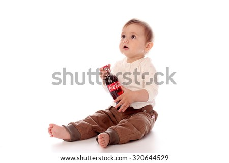 KAZAN, RUSSIA - OCTOBER 18, 2015: Baby with Coca-Cola bottle. Coca-Cola is a carbonated soft drink sold throughout the world.