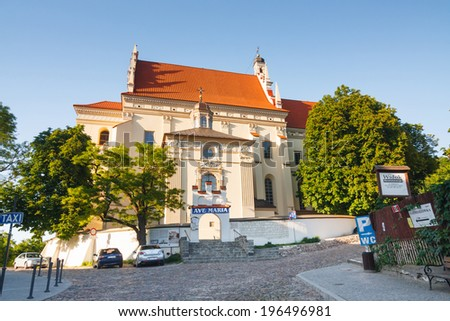 KAZIMIERZ DOLNY, POLAND - MAY 23: Parish church in  the old town of Kazimierz Dolny. This town is an art center in Poland. MAY 23, 2014.