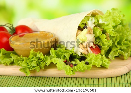 Kebab - grilled meat and vegetables, on bamboo mat, on bright background